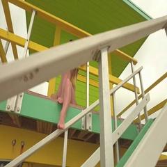 Beautiful woman in bikini sitting at lifeguard station, Miami, USA Stock Footage
