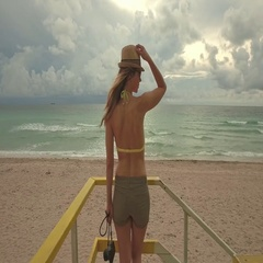 Woman in bikini with photo camera at lifeguard station, Miami, USA Stock Footage