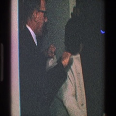 1968: an elderly couple getting ready to step out TOLEDO OHIO Stock Footage
