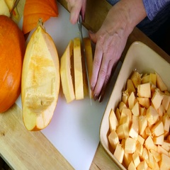 Pumpkin being cut into small pieces. Stock Footage