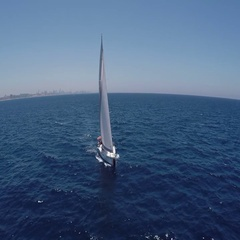 Sailing yachts with white sails in the open Sea. Drone view - birds eye angle. Stock Footage