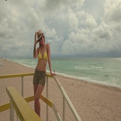 Beautiful woman in bikini at lifeguard station, Miami, USA Stock Footage