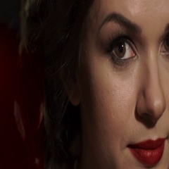 Amazing beautiful woman with red lips raises his head, opens brown eyes looking Stock Footage