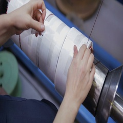Worker operates with electric cooper wires, winding of the transformer Stock Footage