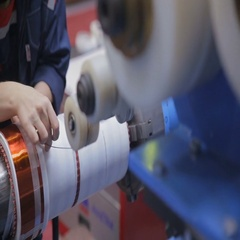 Transformer, engine production. Worker winding cooper wires on a high voltage Stock Footage