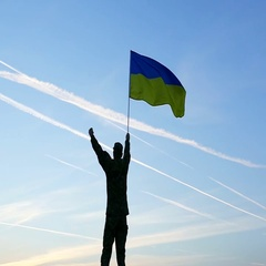 Soldier Waves Ukrainian Flag Against Sunrise Sky. Slow Motion close up Stock Footage