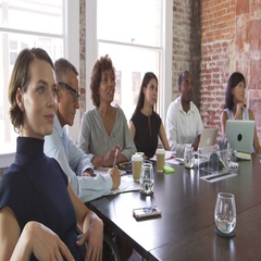 Businesspeople Listen To Boardroom Presentation Shot On R3D Stock Footage