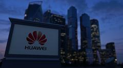 Street signage board with Huawei logo in the evening. Blurred business district Stock Illustration