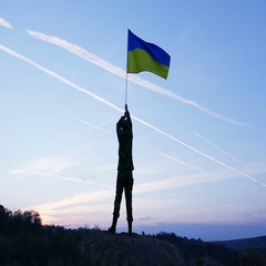 Soldier hold Ukrainian Flag Against Sunrise Sky. Slow Motion  Stock Footage