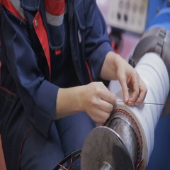 Worker operates with electric cooper wires, winding of the transformer Arkistovideo