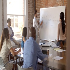 Businessman At Whiteboard In Office Giving Presentation Stock Footage