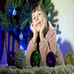New Year's Eve, the child decorate the Christmas tree Stock Footage