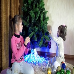 New Year, Christmas children decorate the Christmas tree Stock Footage
