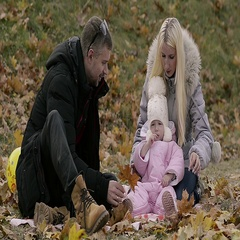 Abstract Young Family in Nature in Autumn Park Stock Footage