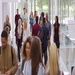 Students and teachers walk in foyer of a modern university, shot on R3D Stock Footage