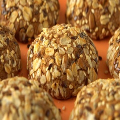 Delicious yummy freshly baked homemade oatmeal cookies rotating on a orange Stock Footage