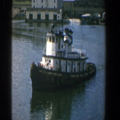 1961: a tow boat moving in the water that is a white color BALTIMORE MARYLAND Stock Footage