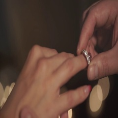 The groom wears a wedding ring a bride in a fabulous location with candles Stock Footage