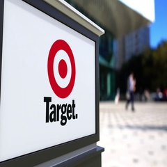 Street signage board with Target Corporation logo. Blurred office center and Stock Footage