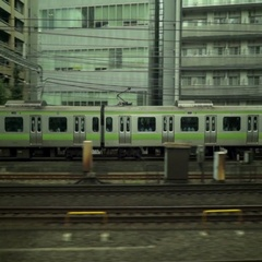 Train overtaking another train in Japan Stock Footage