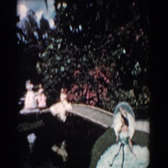 1957: fancy dressed ladies walking down the bridge during the day FLORIDA Stock Footage
