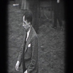 1938: a recording of gentlemen gather at an outdoor park Stock Footage