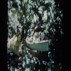1957: a rowboat full of people goes down a creek in the woods FLORIDA Stock Footage
