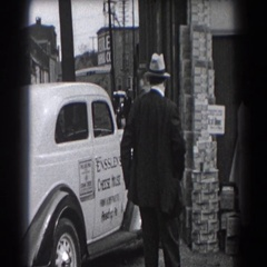 1938: people outside waiting for a ride. READING, PENNSYLVANIA Stock Footage