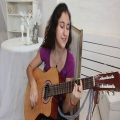 Girl in a white shirt plays guitar in classic style Stock Footage