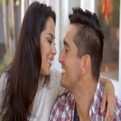 Affectionate Couple Kissing On Steps Outside Home Stock Footage