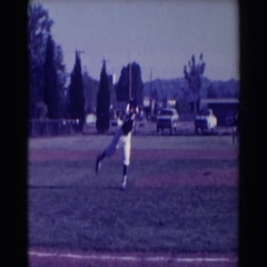 1961: baseball player catching and throwing. NORTH HOLLYWOOD, CALIFORNIA Stock Footage