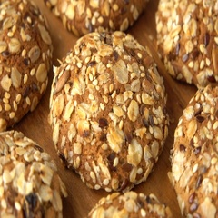 Delicious yummy freshly baked homemade oatmeal cookies rotating on a wooden Stock Footage