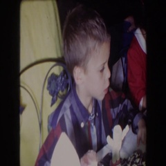 1961: indoor children party eating food curious children NORTH HOLLYWOOD Stock Footage
