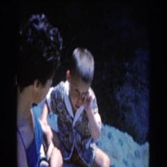 1961: small group of people outside enjoying the weather and having fun  Stock Footage