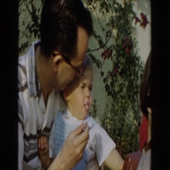 1962: father feeding his son some food. GLENDALE, CALIFORNIA Stock Footage