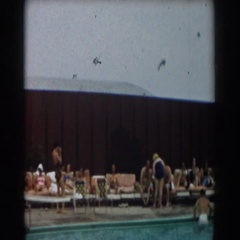 1961: a group of people laying on the lounge chairs gathered outside  Stock Footage