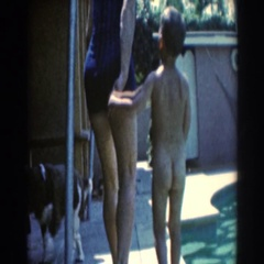1961: mother and son walking around the swimming pool. NORTH HOLLYWOOD Stock Footage