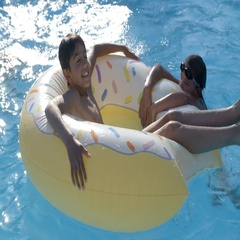 Children Having Fun With Inflatable In Outdoor Swimming Pool Stock Footage