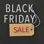 Text black friday sale in a paper label Kuvituskuvat