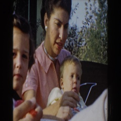 1962: mother feeds toddler with spoon GLENDALE, CALIFORNIA Stock Footage
