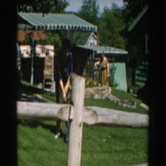 1962: mother helps son with attire at grandmother's house. Stock Footage