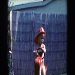1961: little boy playing on a pedal tractor. NORTH HOLLYWOOD, CALIFORNIA Stock Footage