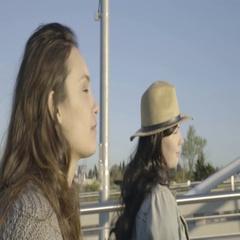 Closeup Of Happy Young Women As They Walk Along Pedestrian Bridge Stock Footage