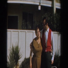 1961: mother and adult son in back yard posing for photos. LOS ANGELES Stock Footage