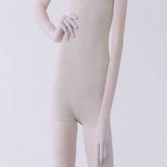 Fit mixed race female showing her perfect body against light grey background Stock Footage