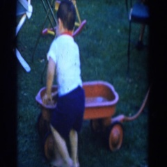 1962: children playing with a little red wagon. GLENDALE, CALIFORNIA Stock Footage