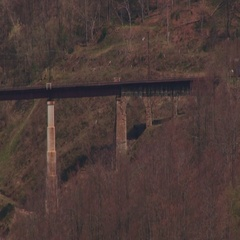 An electric railway viaduct goes to the Carpathian Stock Footage