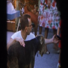 1962: children play with toys gathered around family with pet GLENDALE Stock Footage