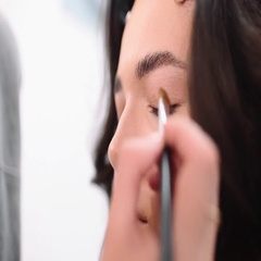 Make up stylist makes smokey eyes effect for woman, girl comes to beauty salon Stock Footage