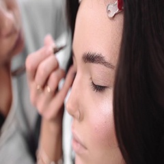 Make up artist paints eyebrows by pencil, woman in beauty salon Stock Footage